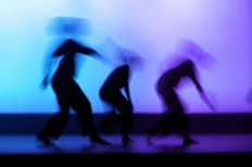 Blurred figures dancing.